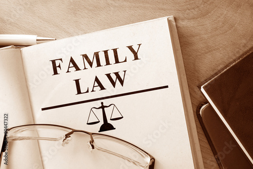 Book with words family law and glasses. Wallpaper Mural