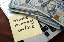 Make Money Online  Concept On A Paper With Notebook.