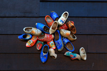 Colorful Wooden Clogs On Dark ...