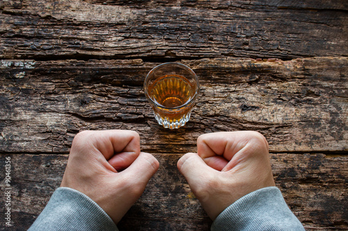 Fotobehang Bar man shows willpower not to drink alcohol