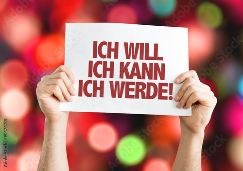 Платно I Want I Can I Will (in German) placard with bokeh background
