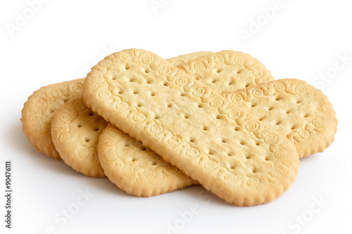 Pile of traditional rich tea english biscuits isolated on white. Fototapeta