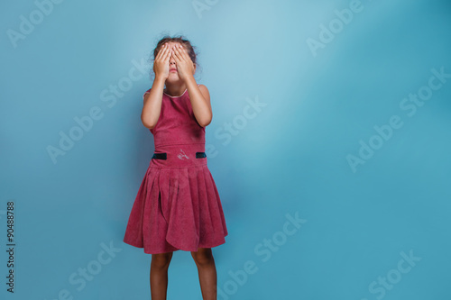 Girl European appearance decade closed eyes with his hands  on a Fototapet