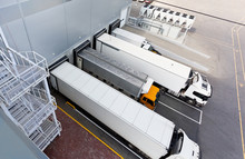Trucks And Gates Of Big Distribution Warehouse