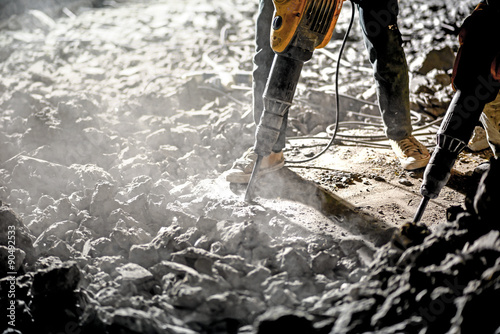 Road repairing works with jackhammer at night Canvas Print