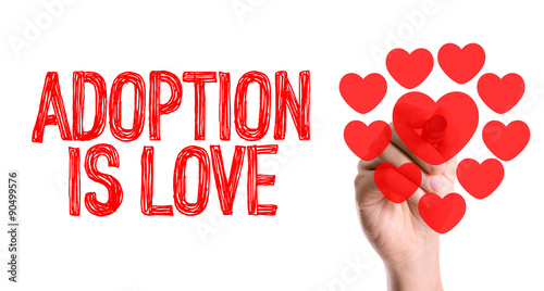 Hand with marker writing the word Adoption Is Love Wallpaper Mural