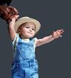 Cute little child in jeans costume.