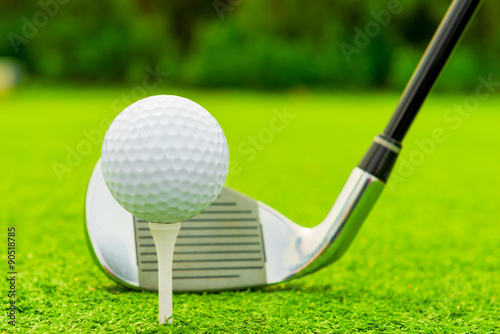 Fotografia, Obraz  ball and putter close-up on green grass