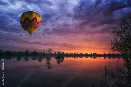 In de dag Aubergine hot air balloon at sunset at the lake landscape natural background