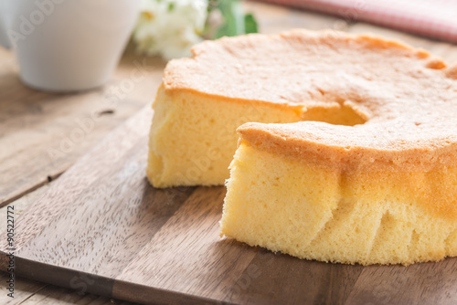 Selective focus, Chiffon cake on wood cutting board. Poster Mural XXL
