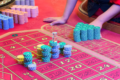 Casino American Roulette gambling table with a playing chips on the layout плакат