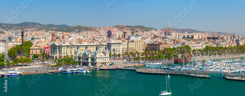 Photo Stands Port The Port of Barcelona has a 2000-year history and great contemporary commercial importance as one of Europe's ports in Mediterranean, and Catalonia's largest port