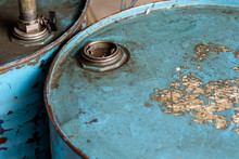 Top View Of Rusted Old Blue Barrel.