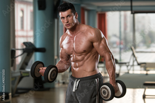 Poster Fitness Young Bodybuilder Exercising Biceps With Dumbbells