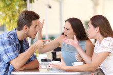 Angry Friends Arguing In A Coffee Shop