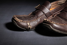 A Pair Of Old Brown Shoes Left Forgotten In The Dark