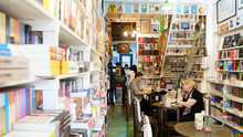 Tourist Is In A Bookshop, Thailand Reading A Book