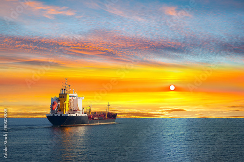 Fotografia  Tanker ship on calm sea in the morning.