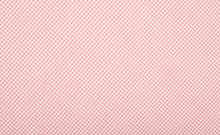 Close Up On Checkered Tablecloth Fabric. Pink With White Tartan Square Pattern As Background.