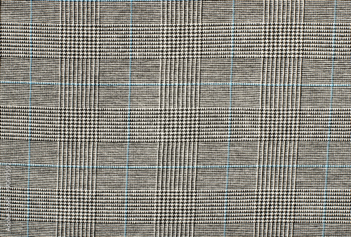 Photo  Black and white with blue houndstooth pattern in squares