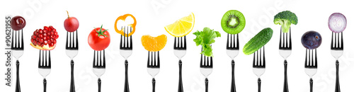 Color fruits and vegetables on fork