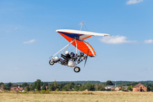 The Motorized Hang Glider Over The Ground