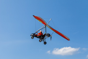 FototapetaThe motorized hang glider over the ground
