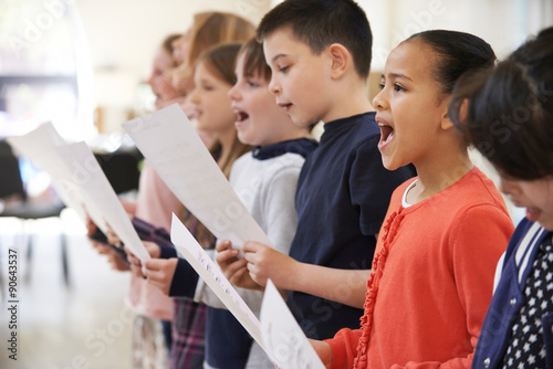Valokuva  Group Of School Children Singing In Choir Together