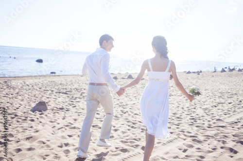 Just Married Hy Running On A Sandy Beach
