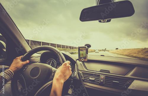 Cuadros en Lienzo  Woman driving a car