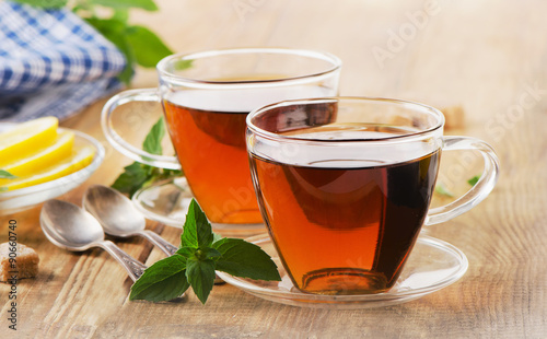 Poster Thee Cups of tea with mint leaves.