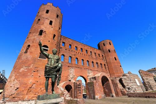 Photo  Porta Palatina - Torino Italy / Roman statue of Gaius Octavius Thurinus and anci