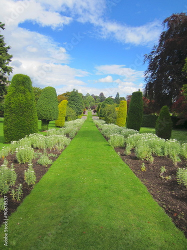 Formal Garden With Lawn Flower Beds And Topiary