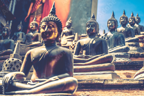 Tuinposter Egypte Buddha statues in Buddhist temple in Colombo, Sri Lanka