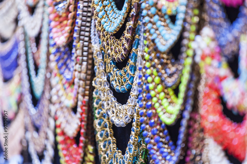 Fotografie, Obraz  Bright costume jewelry of various colors on a show-window of shop