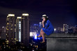 Asian tourist woman sitting on the building rooftop