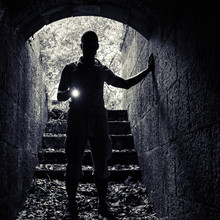 Young Man With A Flashlight En...