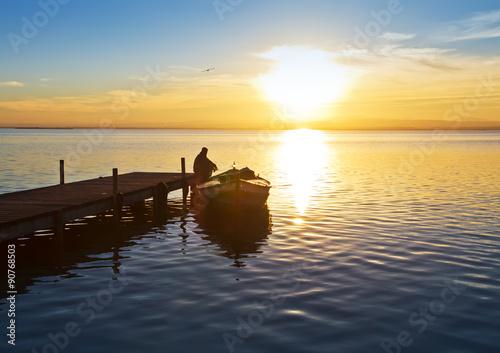 Foto auf AluDibond Pier el hombre que miraba la puesta de sol