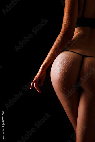 Sexy wet butt girls in underwear over black background плакат