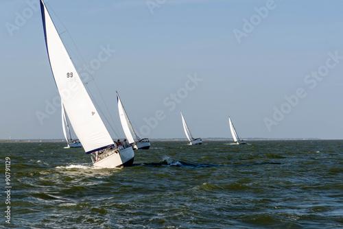 sailing yacht in the open ocean © Casey E Martin
