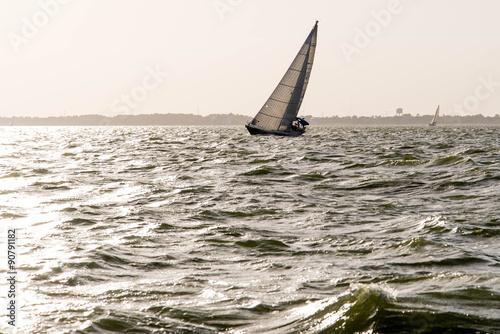 Poster Zeilen sailing yacht in the open ocean