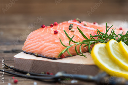 Poster Fish Raw Salmon Fish Fillet with Lemon and Fresh Herbs