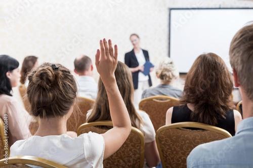Photo Listener raising hand to ask