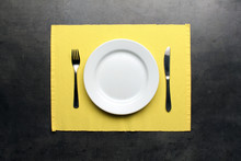 Empty Plate, Cutlery And Yello...