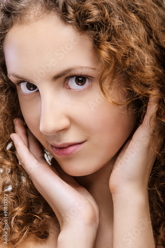 Fotografija  Portrait of beautiful curly girl