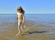 Adorable funny baby girl splashing in the water
