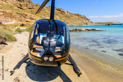 Poster Helicopter Small private helicopter on the beach of Paros island, Cyclades, Greece.