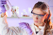 Young scientist pipetting in life science laboratory.