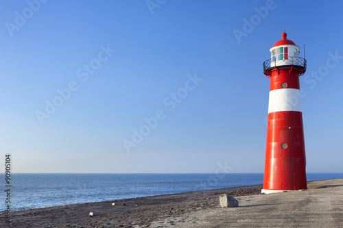 Garden Poster Lighthouse Red and white lighthouse and a clear blue sky