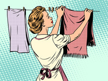 Woman Hangs Clothes After Wash...